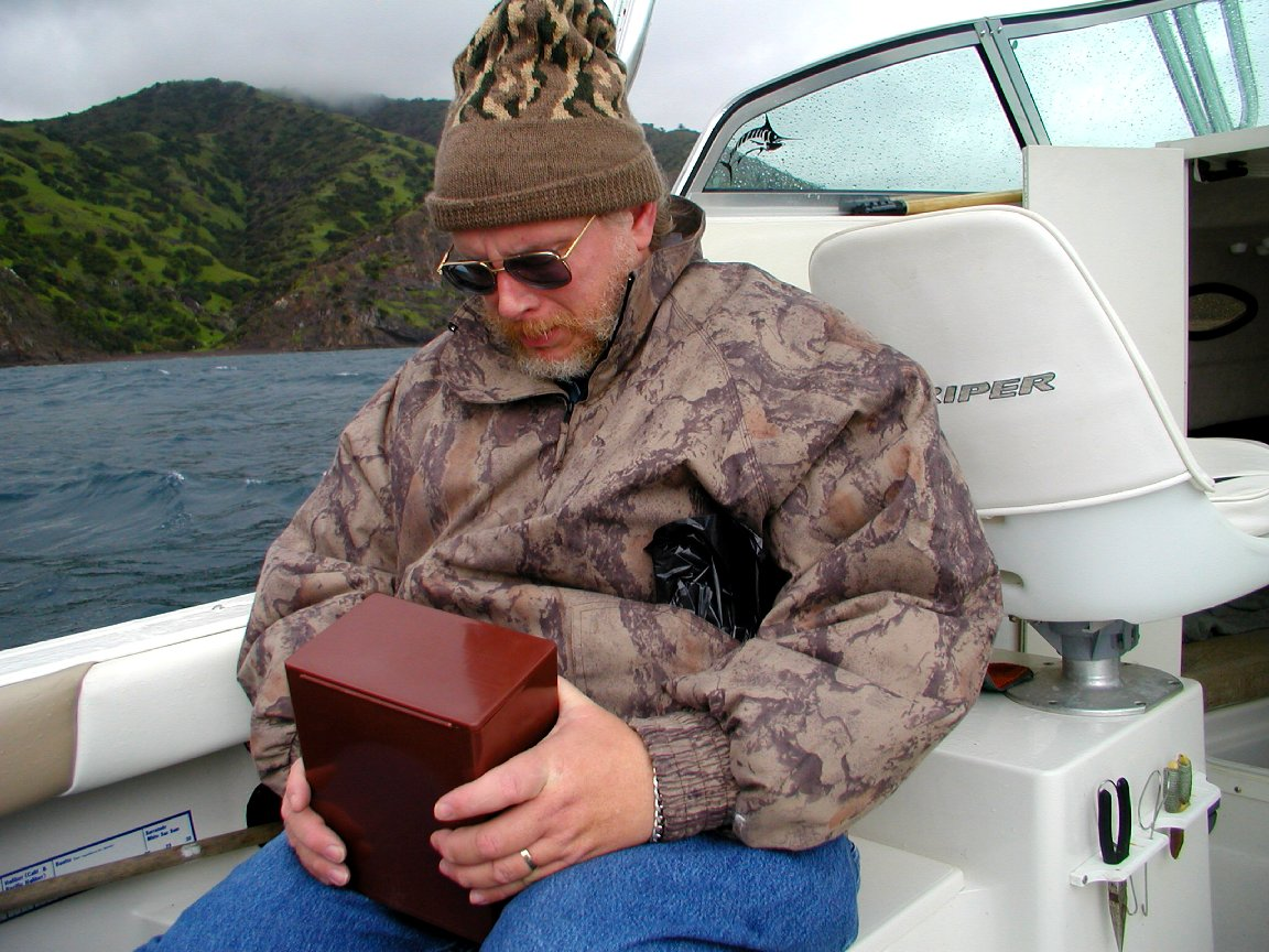 On a boat near Catalina Island, about to pour Claudia's ashes into the ocean during a massive storm